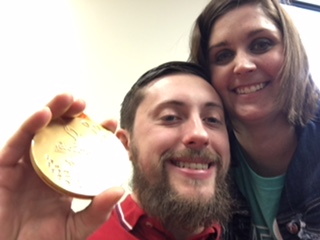John Gilbert (left) shows his gold medal, with MERIL's Lauren Lynch.