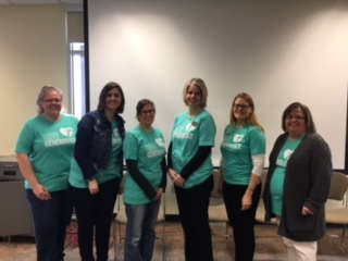 "RTN members wearing Thrivent ""Live Generously"" shirts."
