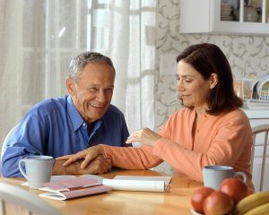 Man interviewing a caregiver.