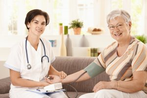 In-home nurse with patient
